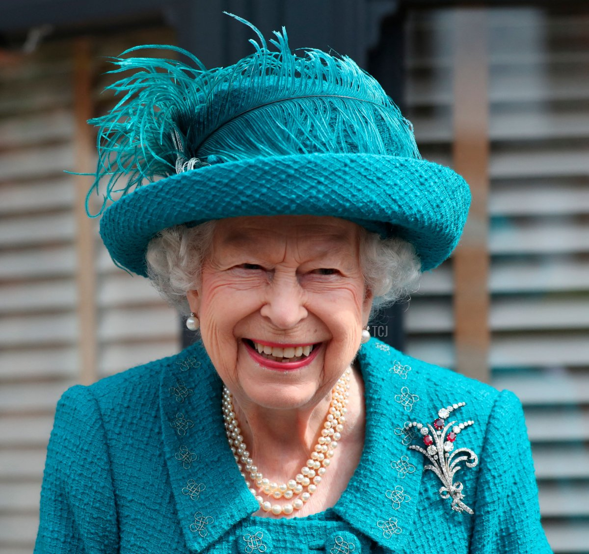 Britain's Queen Elizabeth II visits the set of the long running television series Coronation Street in Manchester, northwest England on July 8, 2021