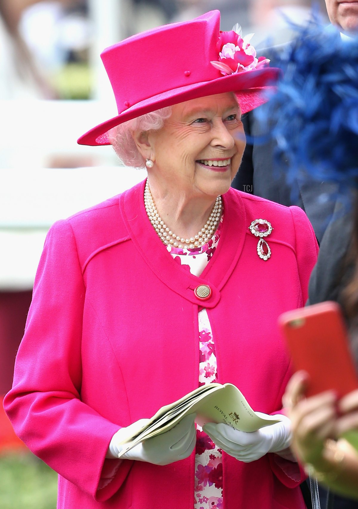 Queen Elizabeth II smiles in the parade ring on day 1 of Royal Ascot at Ascot Racecourse on June 16, 2015 in Ascot, England