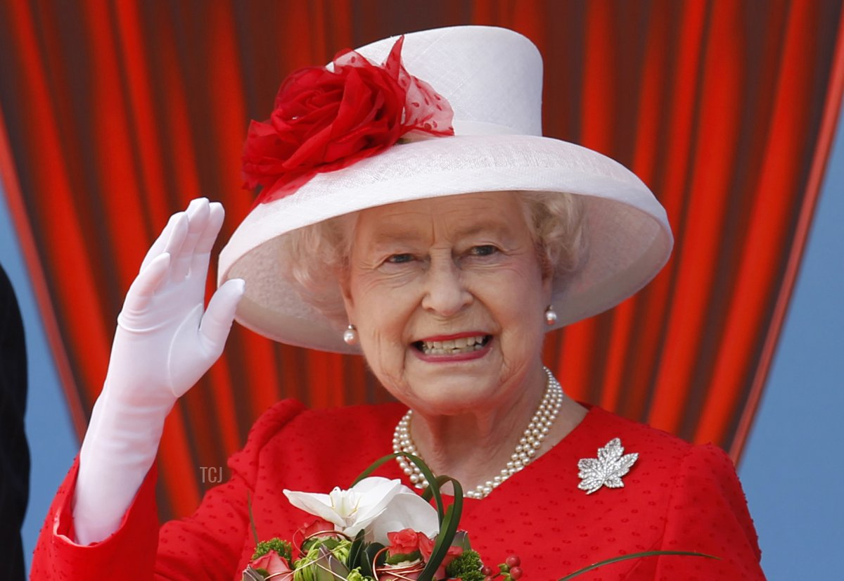 Queen Elizabeth II waves to some of the thousands of Canadian who turned out to celebrate Canada Day with her on Parliament Hill in Ottawa, Ontario, July 1, 2010