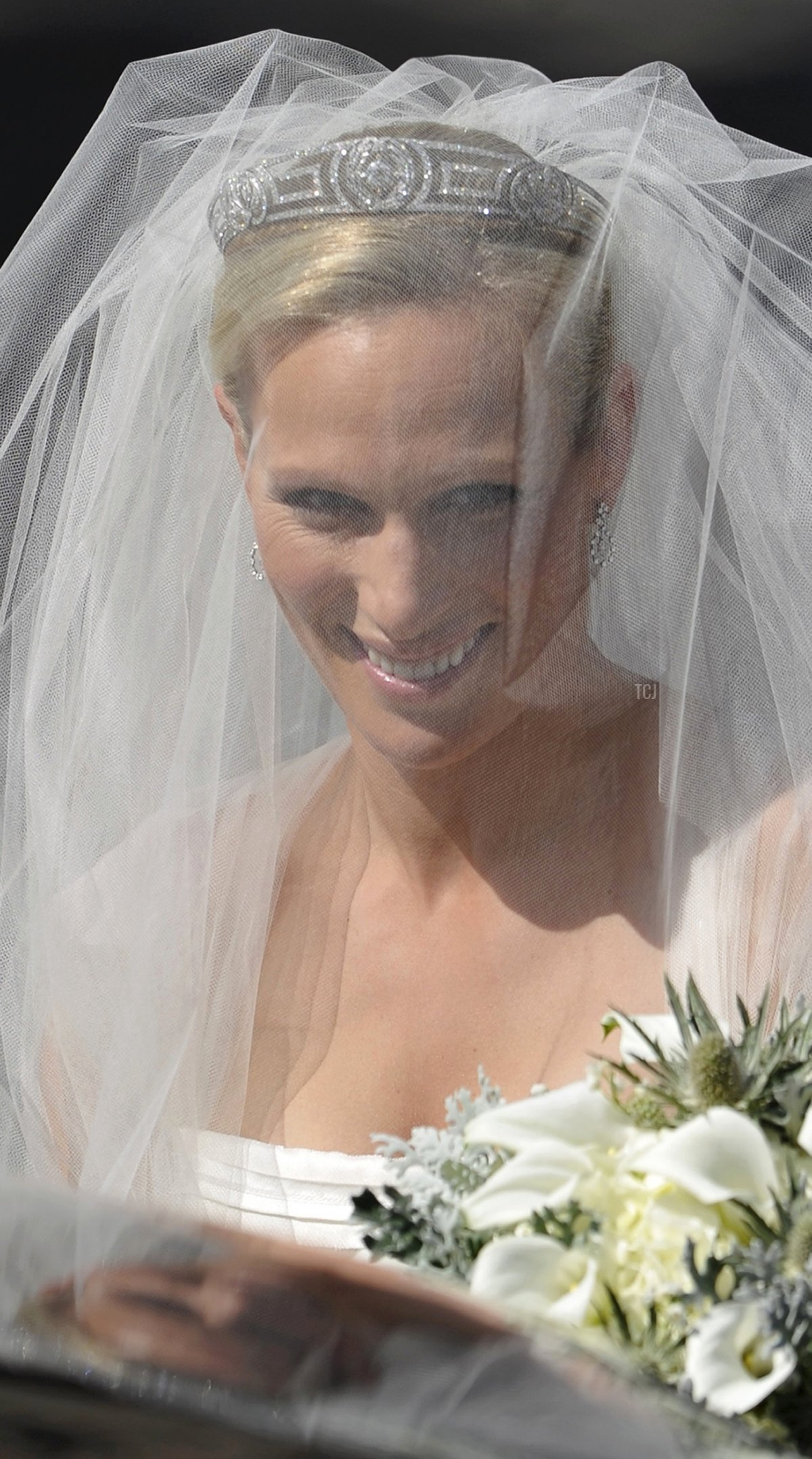 Britain's Zara Phillips, the eldest granddaughter of Queen Elizabeth II, arrives for her wedding to England rugby player Mike Tindall at Canongate Kirk in Edinburgh, Scotland, on July 30, 2011