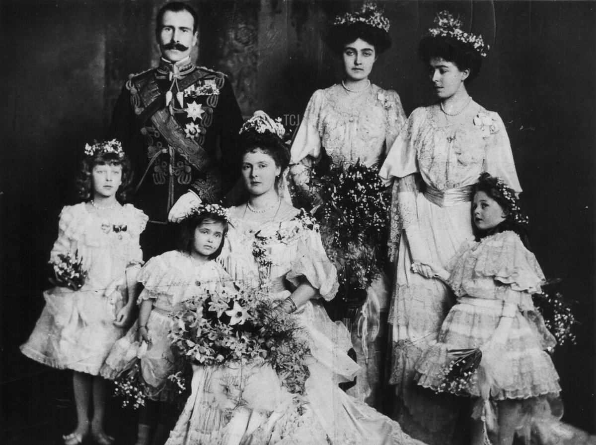 The wedding of Prince Alexander and Princess Alice, later Earl and Countess Athlone, in a posed portrait with their bridesmaids, February 10th 1904