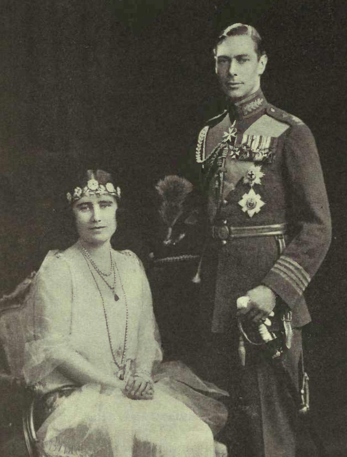 Portrait photograph of Prince Albert, Duke of York (later to be King George VI) in the full dress uniform of an RAF group captain and his bride, Elizabeth Bowes-Lyon, in 1927