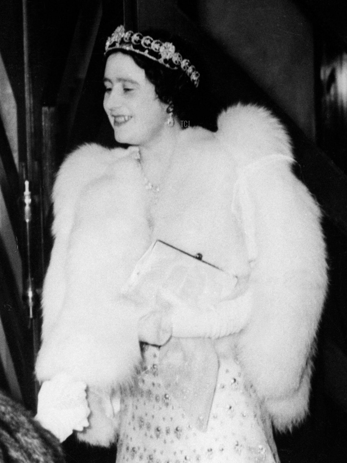 Queen Elizabeth of the United Kingdom (later the Queen Mother) wears the Teck Crescent Tiara for a performance by the Comedie Francaise at the Savoy Hotel in London, March 1939
