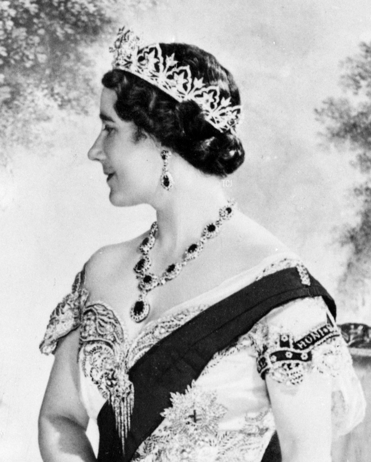 Queen Elizabeth, the former Duchess of York smiles as she poses in 1937 for official picture in London after the Coronation 12 May 1937 of the Duke of York
