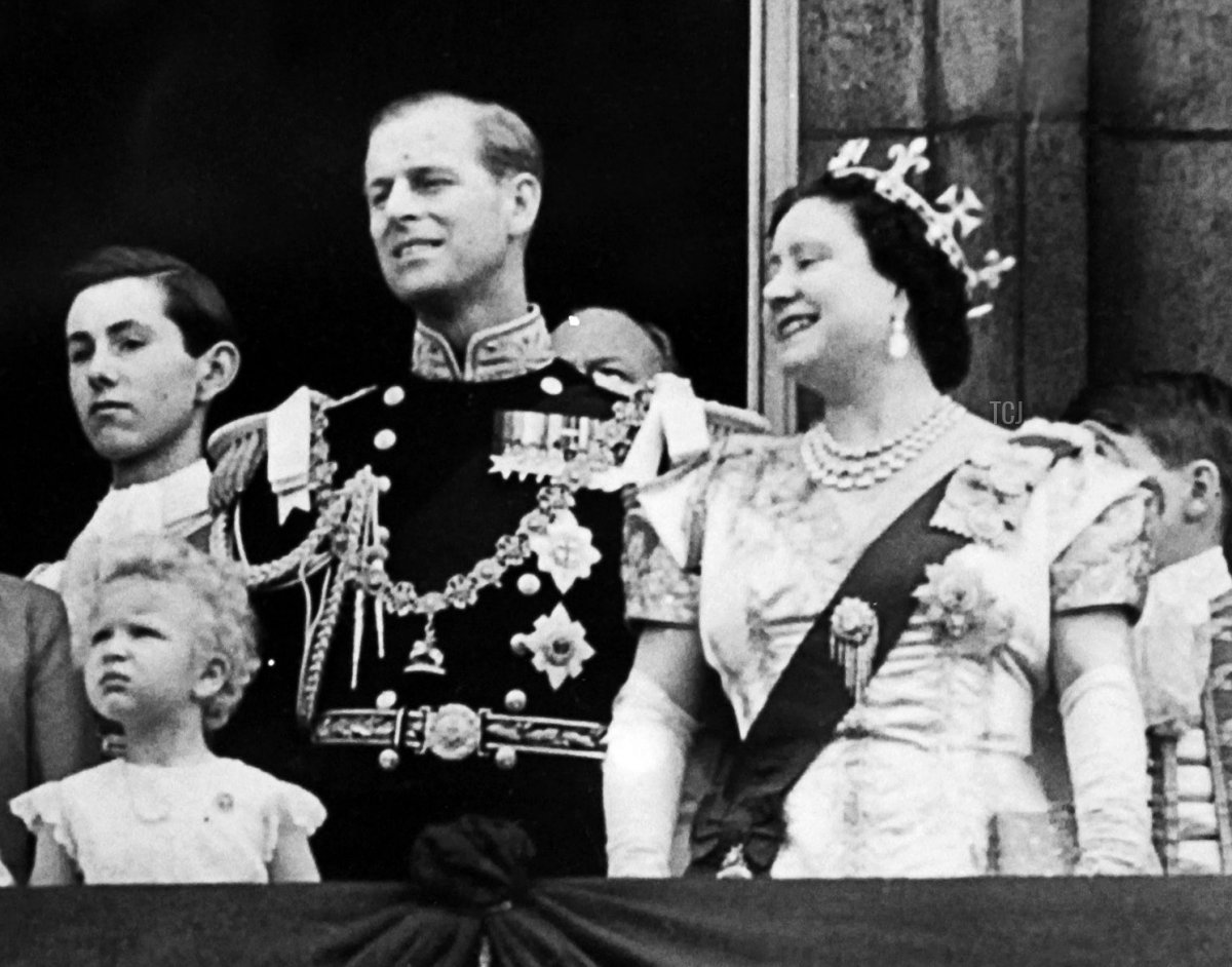 Princess Anne, Prince Philip, and the Queen Mother appear on a balcony of Buckingham Palace, on Coronation day, on June 02, 1953 in London