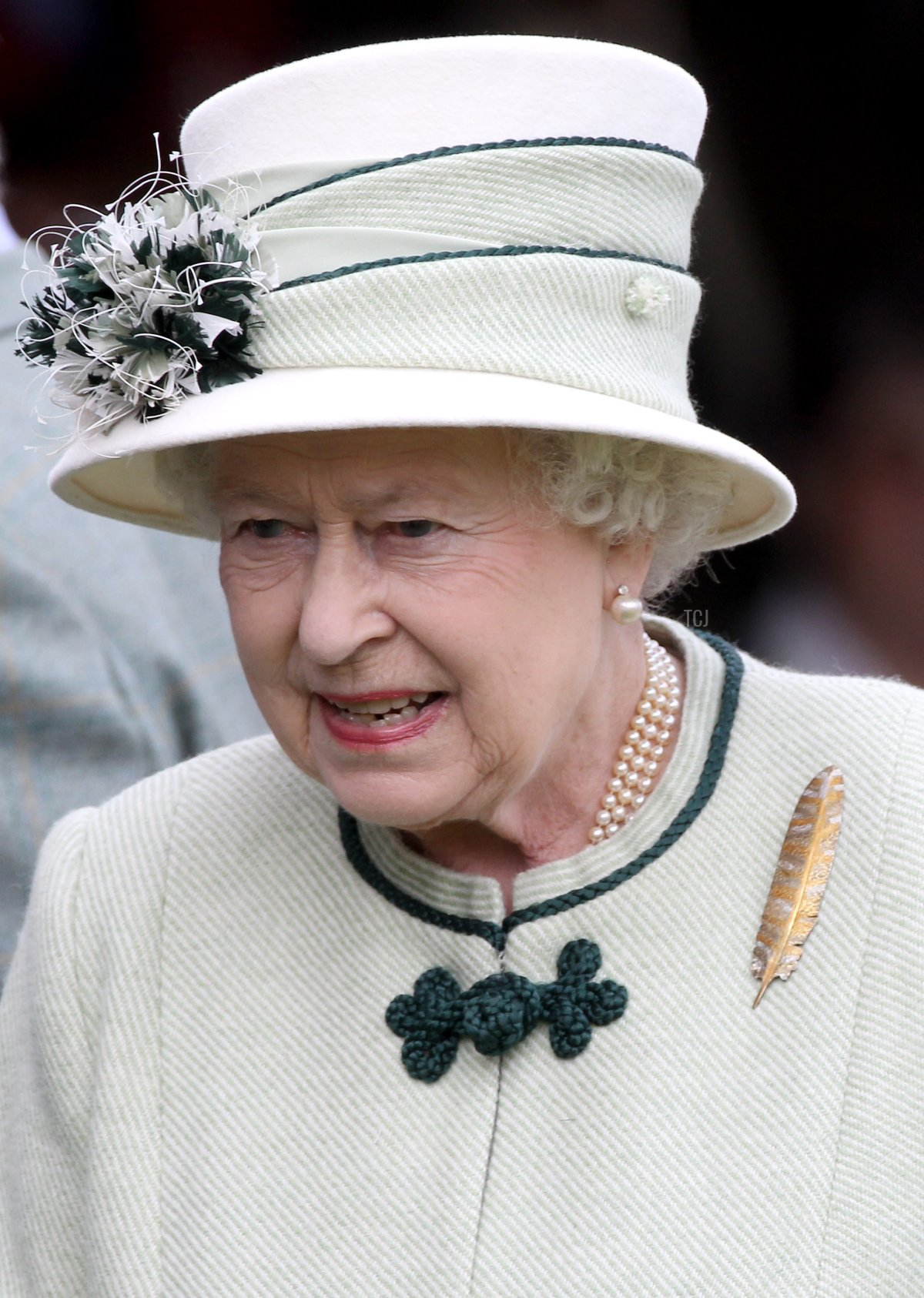 Queen Elizabeth II smiles as she looks out from the royal box during the Braemar Highland Games at The Princess Royal and Duke of Fife Memorial Park on September 4, 2010 in Braemar, Scotland