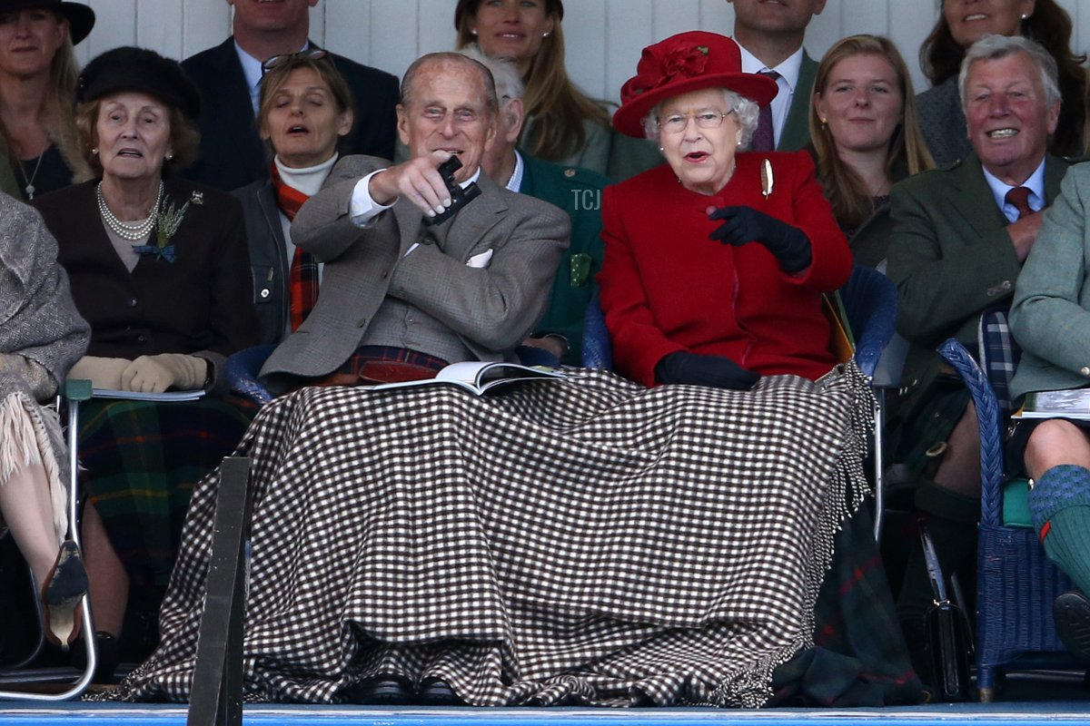Queen Elizabeth II and Prince Philip, Duke of Edinburgh watch competitors at the Braemar Gathering on September 5, 2015 in Braemar, Scotland