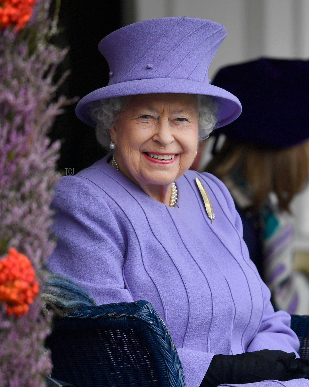 Queen Elizabeth II watches competitors at the Braemar Gathering on September 3, 2016 in Braemar, Scotland