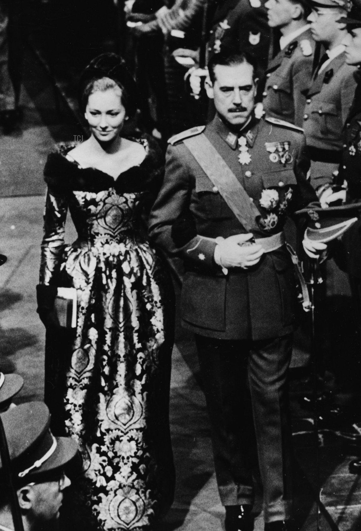 Princess Paola of Belgium and the Marquis Of Aguilar leaving the Collegiate Church of St Michel and Gudule arm in arm, following the wedding of King Baudouin of Belgium, Brussels, December 16th 1960