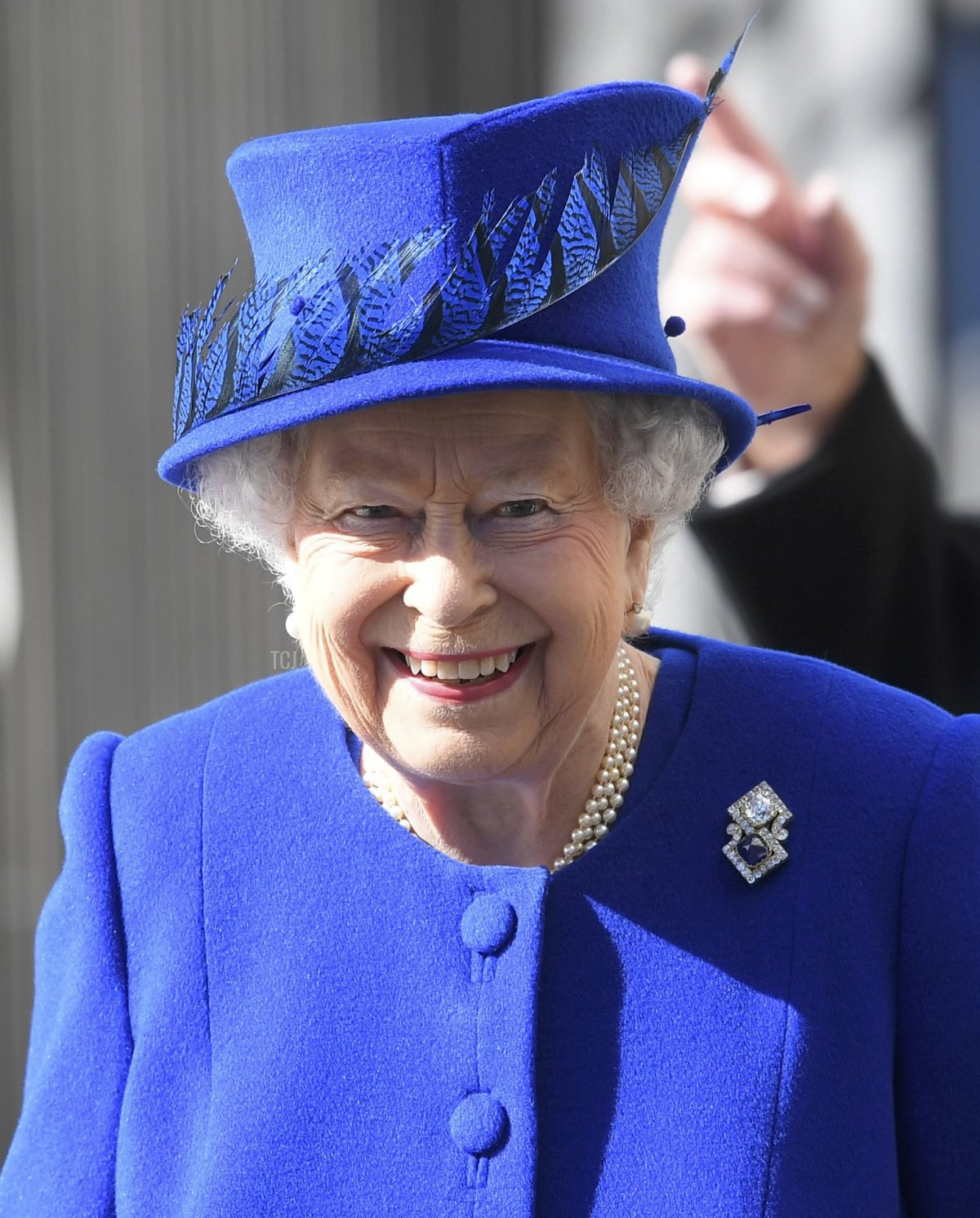 Queen Elizabeth II arrives with flowers for the unveiling of the new memorial to members of the armed services who served and died in the wars in Iraq and Afghanistan at Victoria Embankment Gardens on March 8, 2017 in London, England