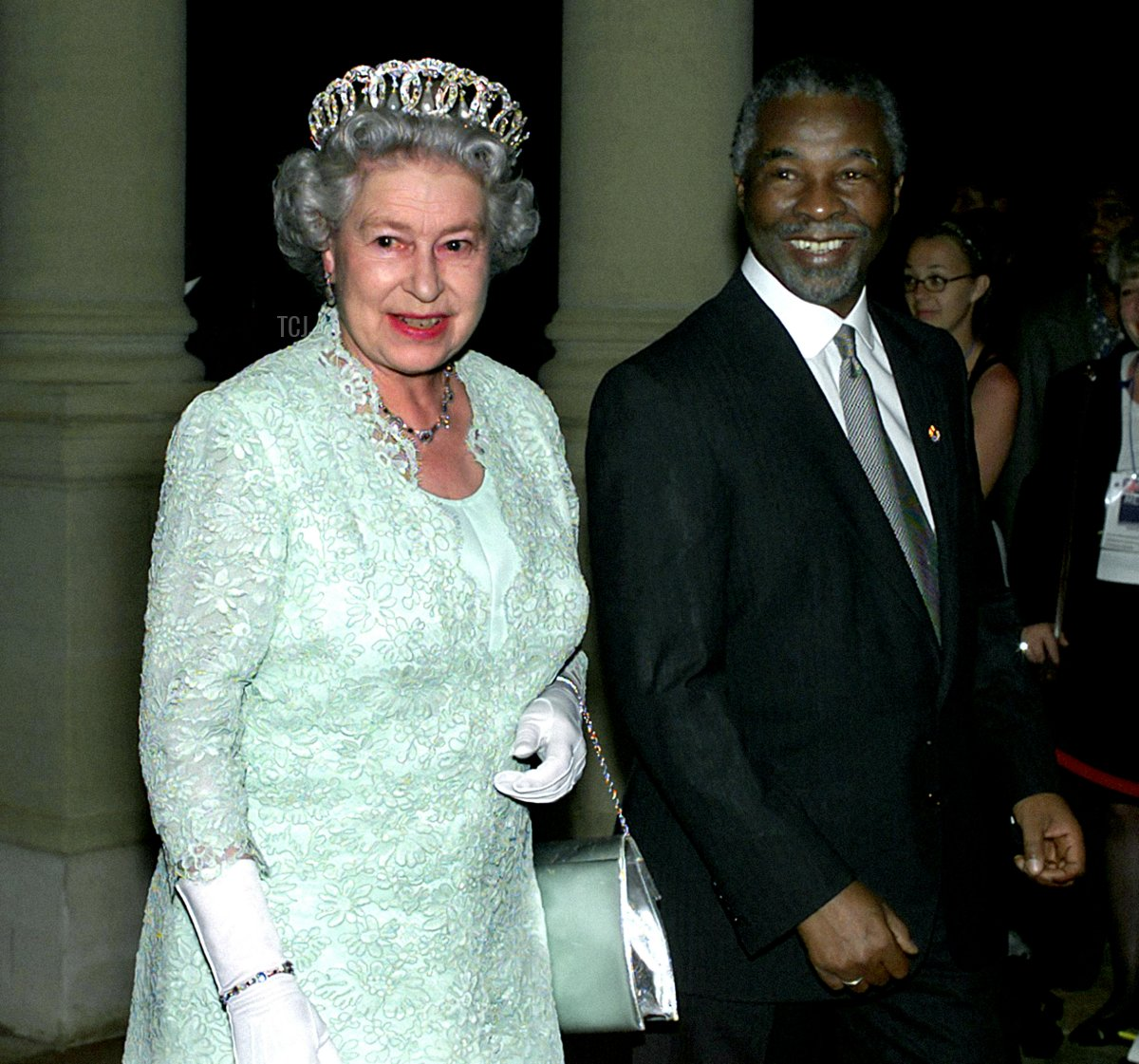 South African President Thabo Mbeki accompanies HM Queen Elizabeth II to a state banquet held in her honour at the Presidential Guest House, Pretoria, Nov 1999