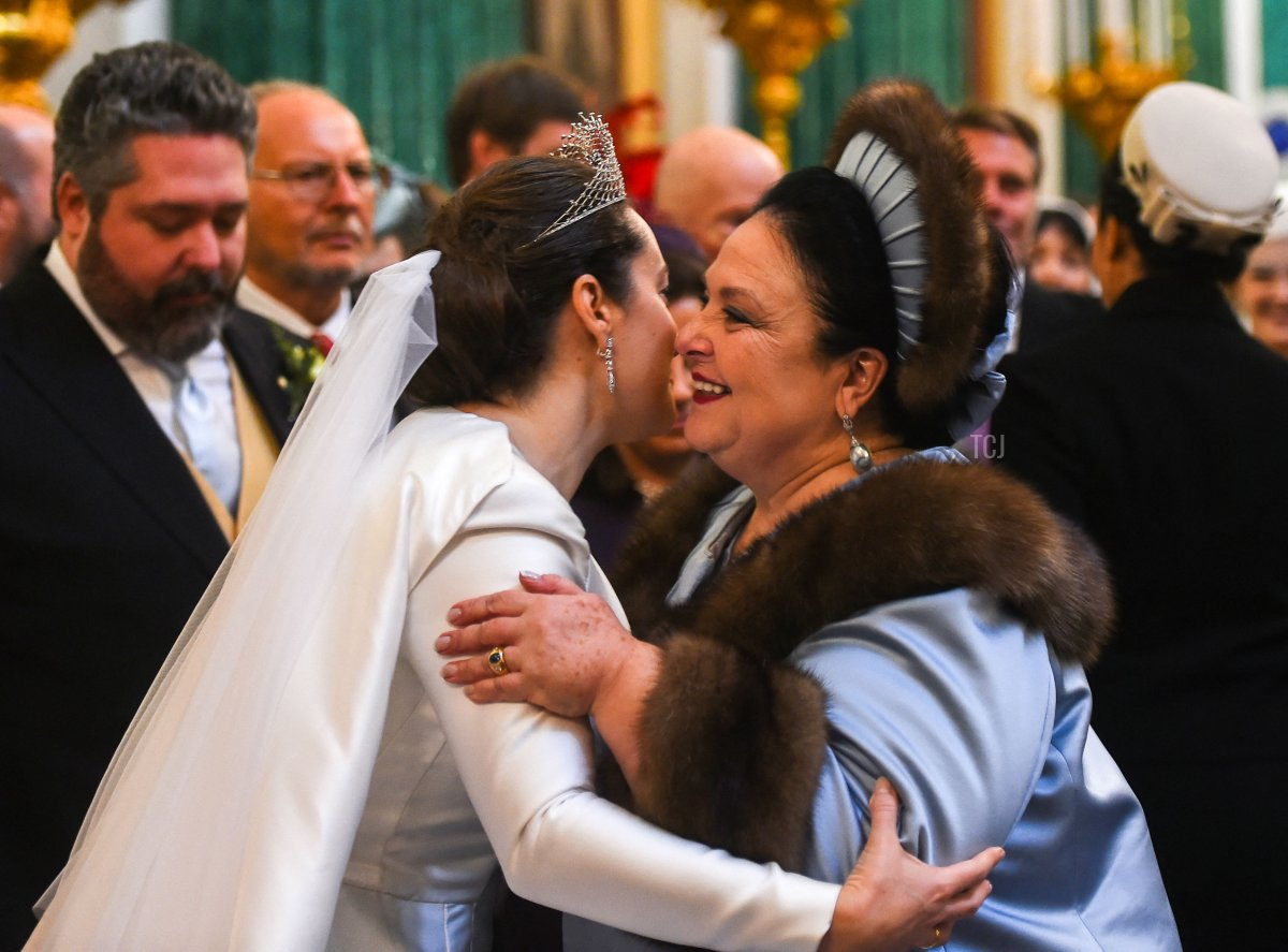 Grand Duchess Maria Vladimirovna of Russia (R), a mother of Grand Duke George Mikhailovich Romanov (L) congratulates Victoria Romanovna Bettarini during their wedding ceremony at Saint Isaac's Cathedral in Saint Petersburg, on October 1, 2021