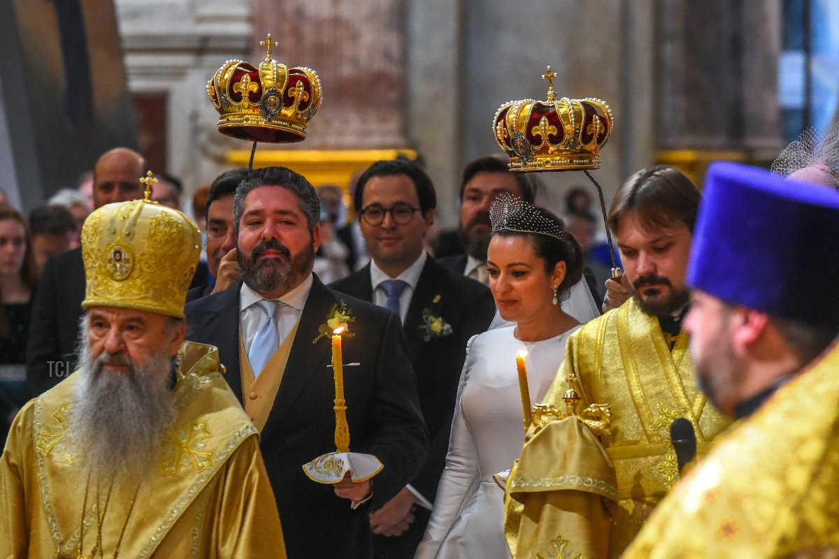 Grand Duke George Mikhailovich Romanov and Victoria Romanovna Bettarini react during their wedding ceremony at Saint Isaac's Cathedral in Saint Petersburg, on October 1, 2021