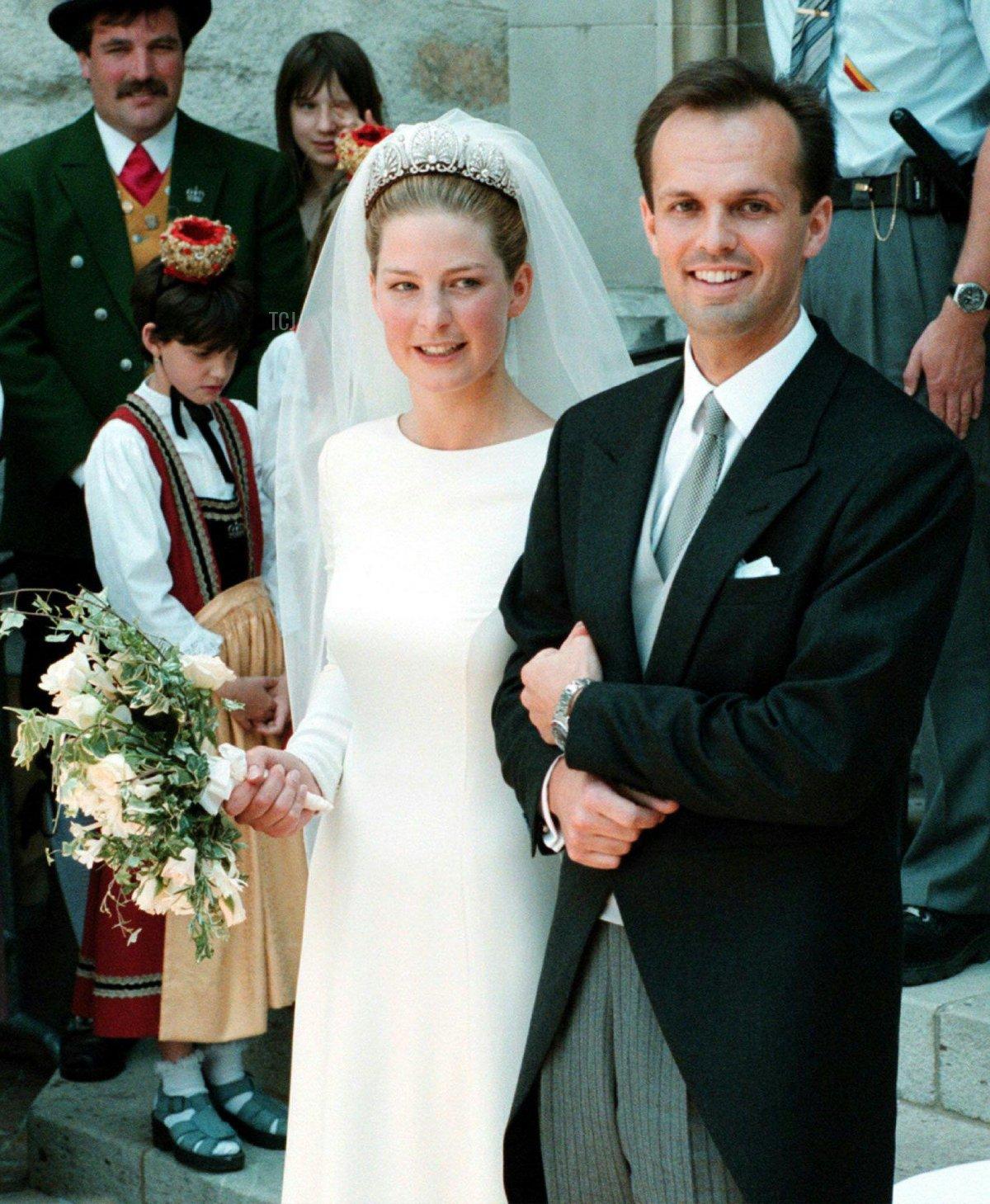 Princess Tatjana of Liechtenstein (L) and German businessman Philipp von Lattorff leave the cathedral in Vaduz after their wedding June 5, 1999
