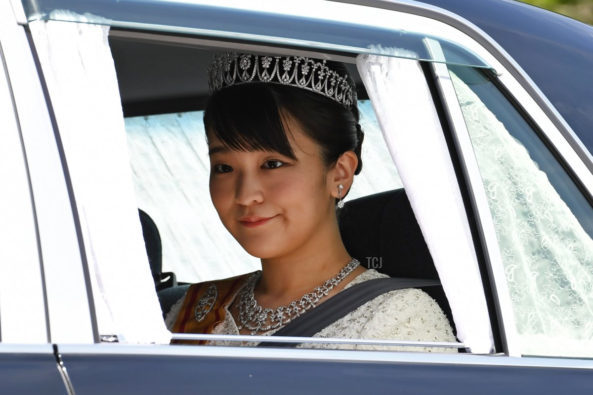 A vehicle carrying Japans Princess Mako, daughter of Crown Prince Akishino, leaves the Imperial Palace in Tokyo on May 1, 2019