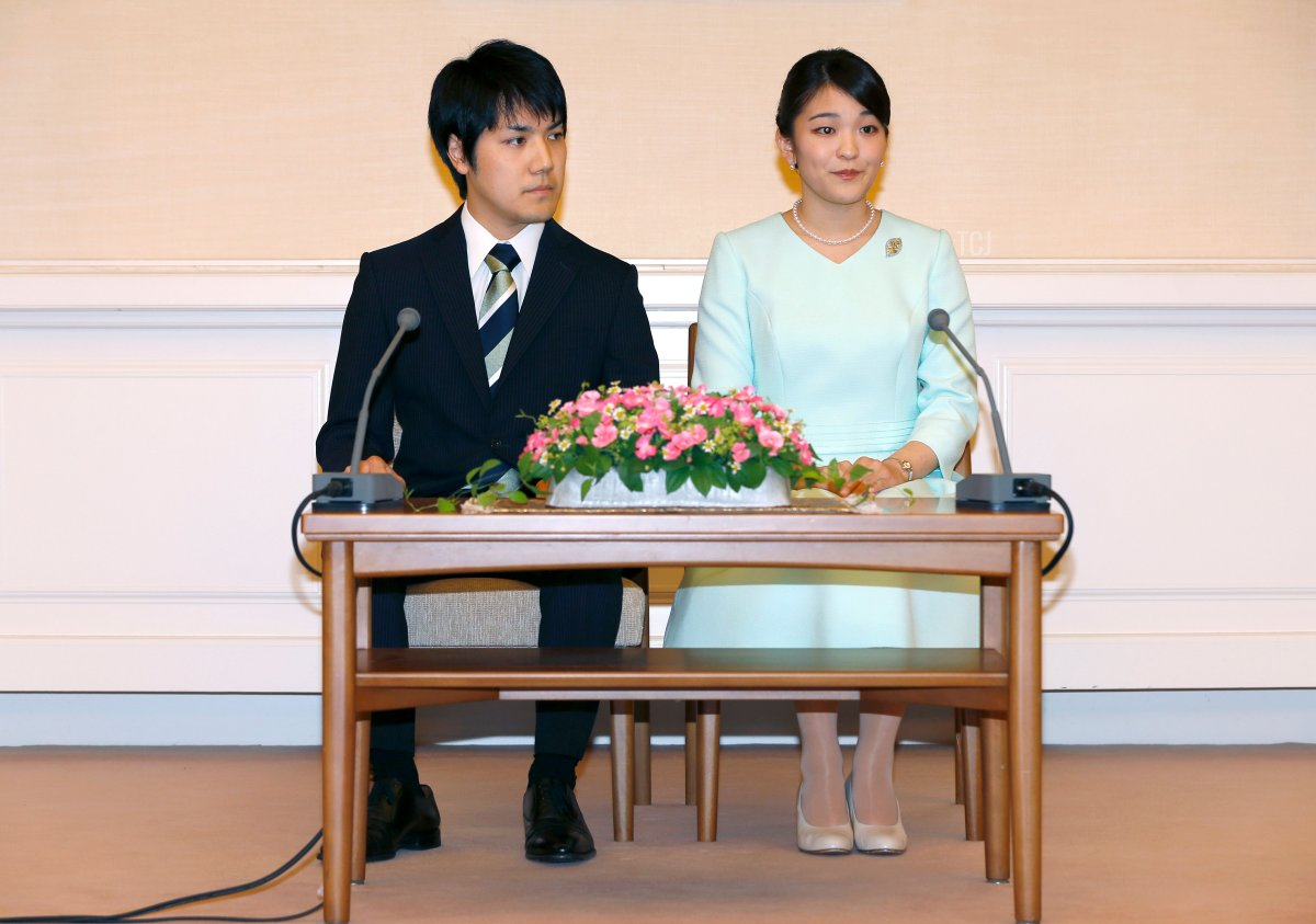 Princess Mako (R), the eldest daughter of Prince Akishino and Princess Kiko, and her fiancee Kei Komuro (L), take part in a press conference to announce their engagement at the Akasaka East Residence in Tokyo on September 3, 2017