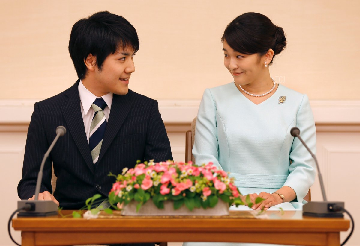 Princess Mako (R), the eldest daughter of Prince Akishino and Princess Kiko, and her fiancee Kei Komuro (L), smile during a press conference to announce their engagement at the Akasaka East Residence in Tokyo on September 3, 2017