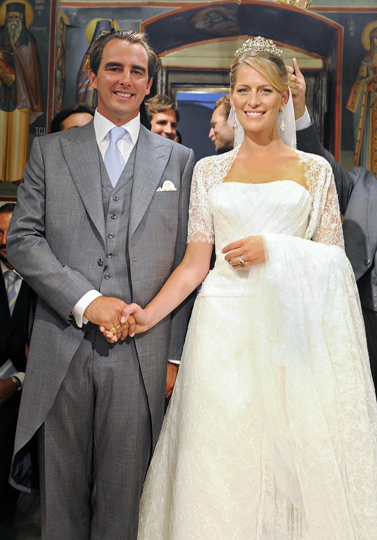 Prince Nikolaos of Greece and Tatiana Blatnik pose during their wedding ceremony in Saint Nicolas church at the island of Spetses on August 25, 2010