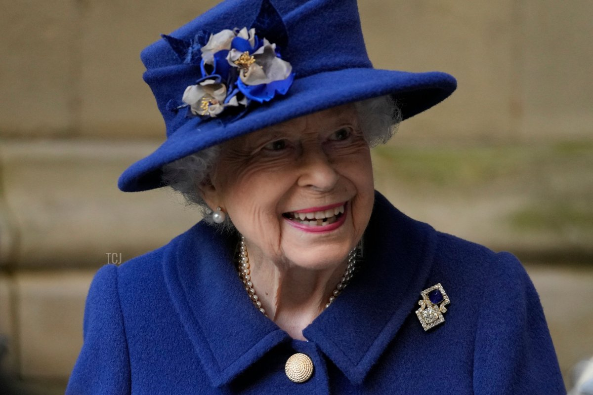 Britain's Queen Elizabeth II smiles as she leaves after attending a Service of Thanksgiving to mark the Centenary of the Royal British Legion at Westminster Abbey in London on October 12, 2021