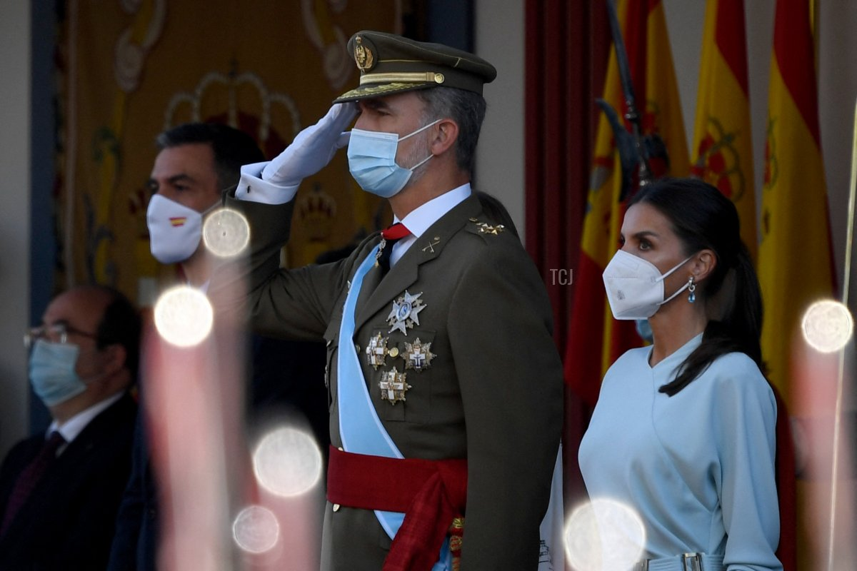 Spain's Prime Minister Pedro Sanchez (L), King Felipe VI of Spain (C) and Queen Letizia of Spain (R) attend the Spanish National Day military parade in Madrid on October 12, 2021
