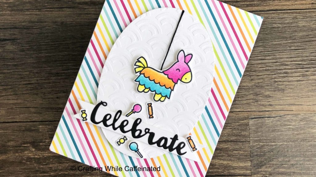 A handmade birthday card with a dry embossed background. The background is dry embossed with the Waves Cake amd Cookie stencil from the Crafter's Workshop