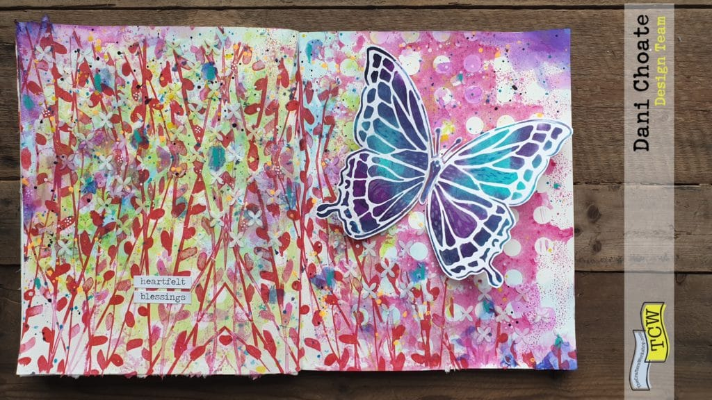 full art journal page showing butterfly in a field of flowers