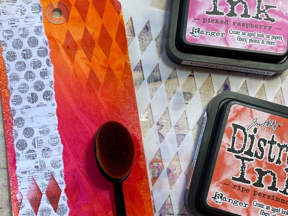 Sponge tag with Distress Inks in colours that match background