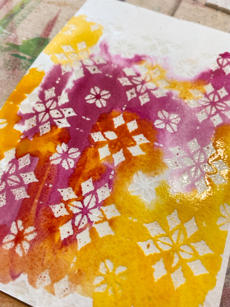 Embossed background painted with watercolour.