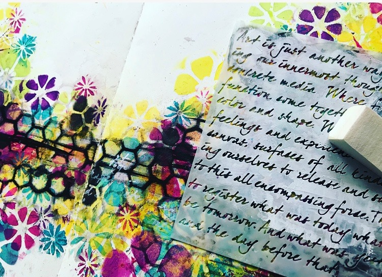 Art is Stencil added with white paint to background of colorful art journal page