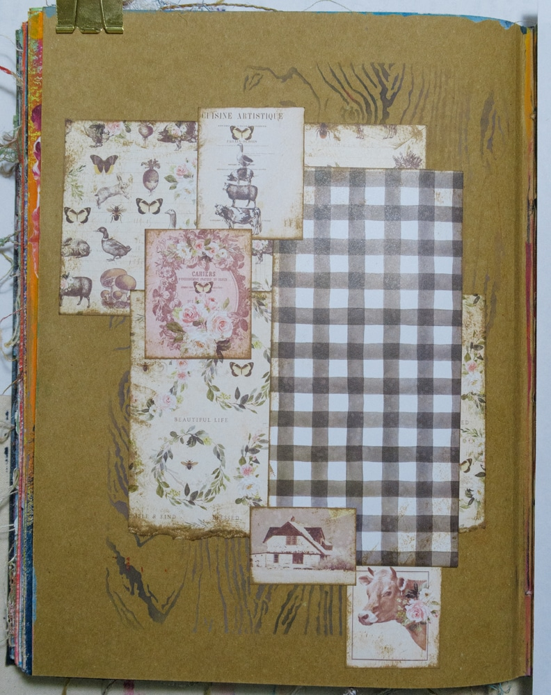 Adhering patterned papers over background. Each is inked with brown ink first.