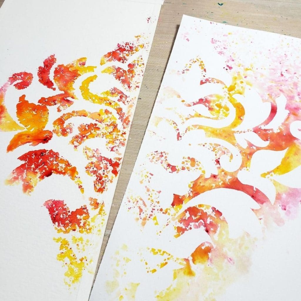 Sprinkle the powers through the stencil and spray with water.