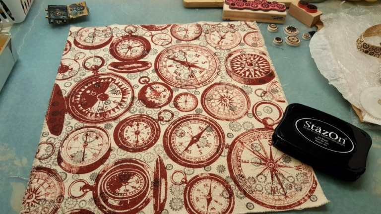 Image showing the clock patterned fabric stamped randomly with multiple gears rubber stamps using permanent black ink.