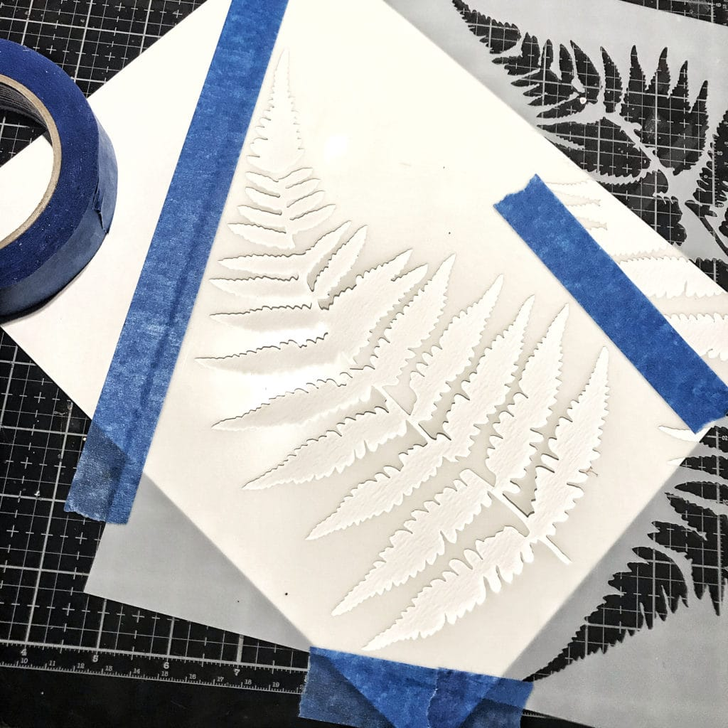 TCW243 Ferns Stencil taped down onto TCW9051 Watercolor Paper with painters tape