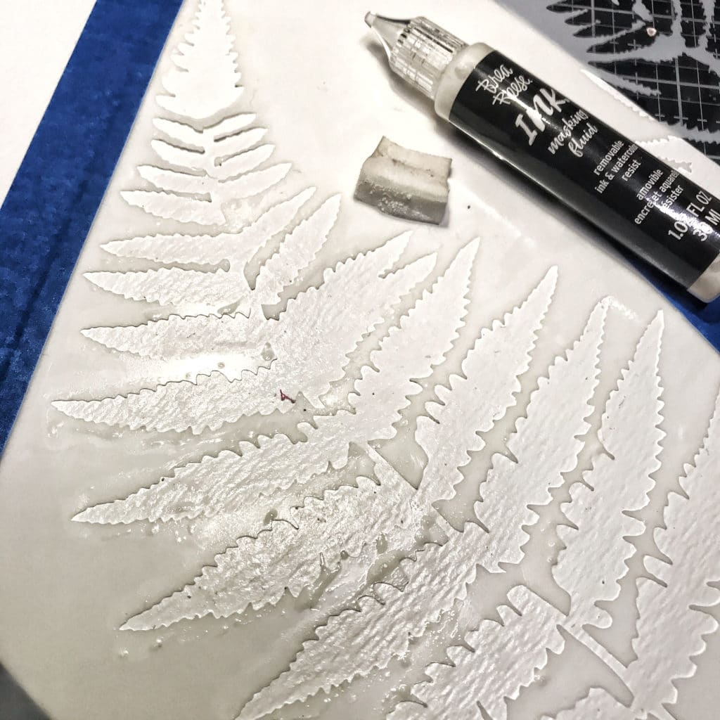 Brea Reese Masking fluid with cosmetic sponge through TCW243 Ferns Stencil taped down onto TCW9051 Watercolor Paper with painters tape