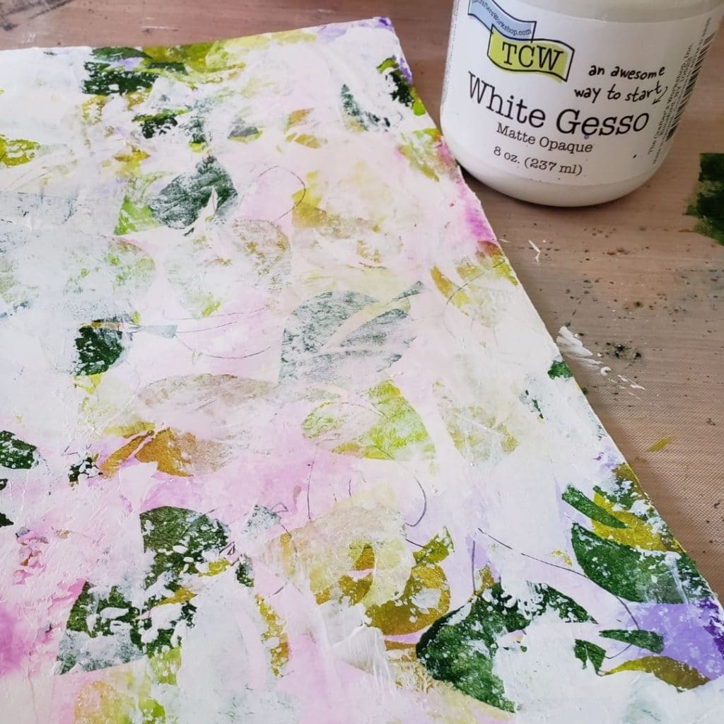 Add Gesso the the page to tone down the background