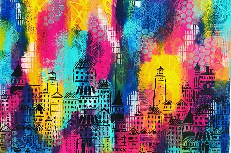 black paint rubbed through cityscape stencils by TCW with a rainbow background