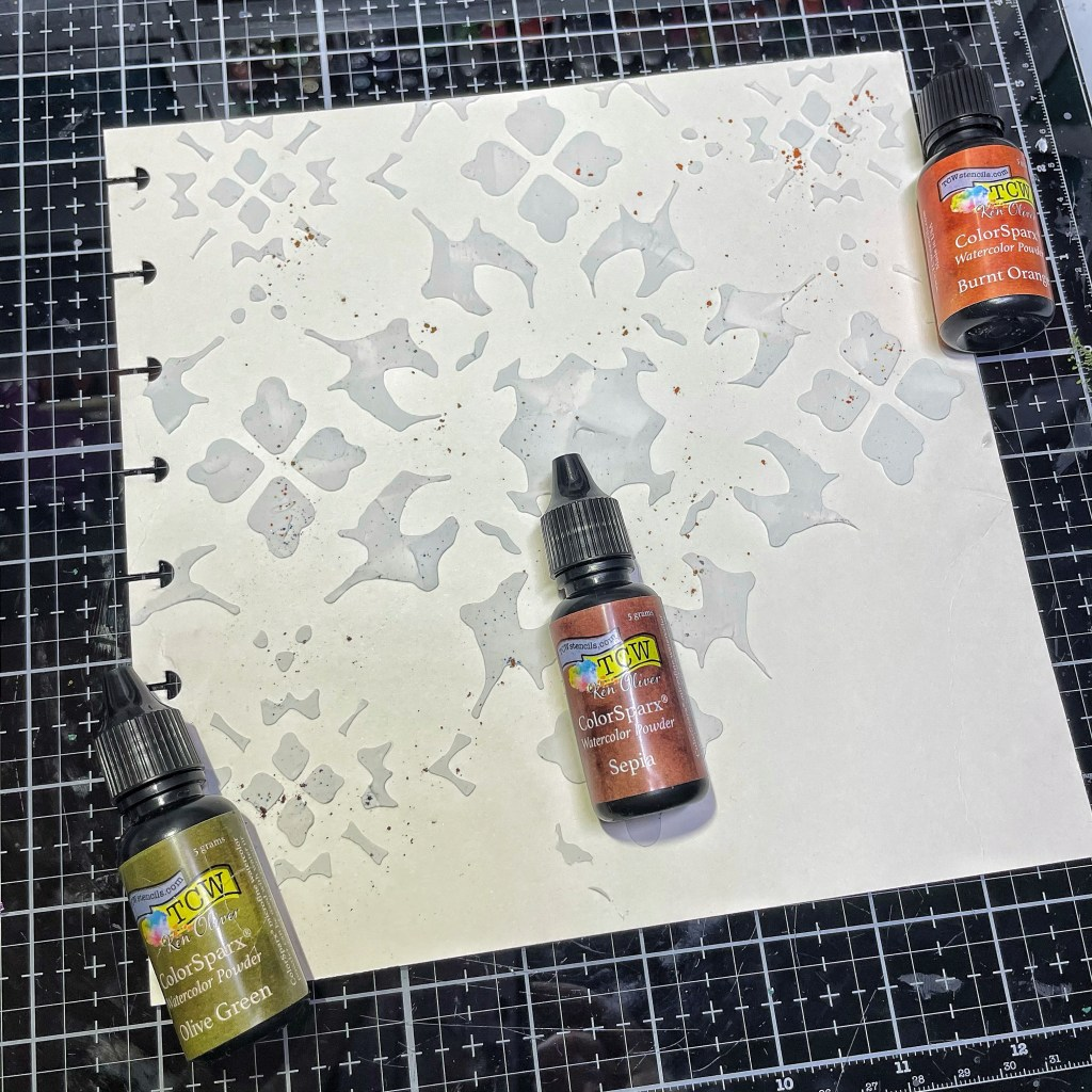 Sepia, Olive Green, and Burnt Orange Color Spark Watercolor Powder- dry on page