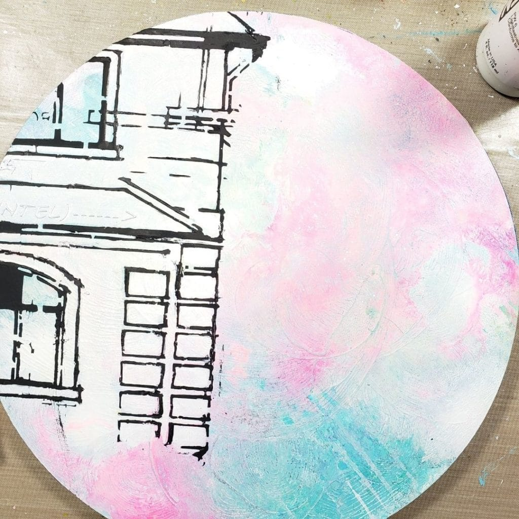 I added gesso, turquoise and pink acrylic paints to the panel and I painted the house white.