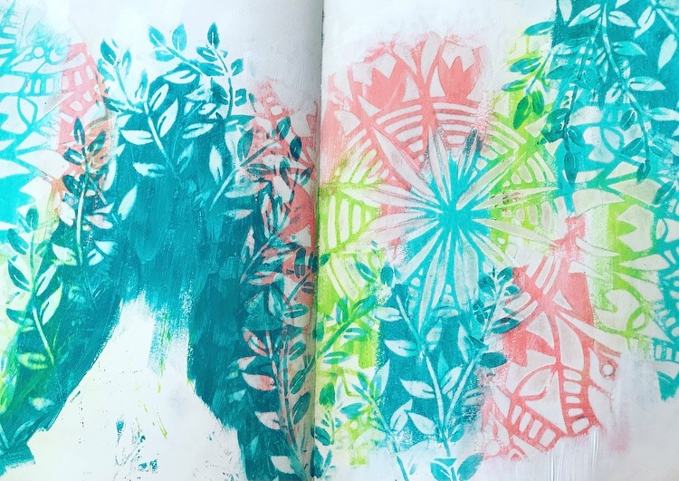 completed background of an art journal page. Features leaves and a mandala