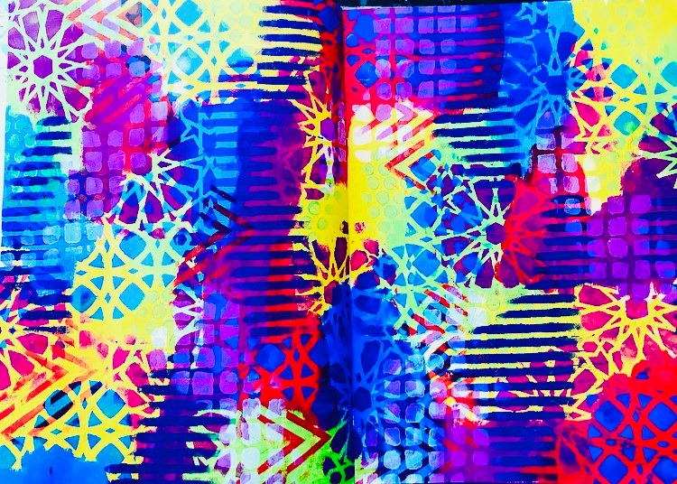 brightly colored art journal background with lots of The Crafters Workshop stencils
