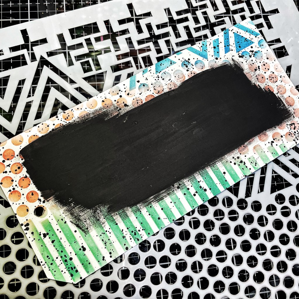 black paint Swatch on top of inked tag