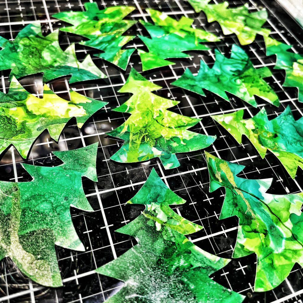 Cut alcohol ink Christmas trees through TCW5032 Single Tree Stencil