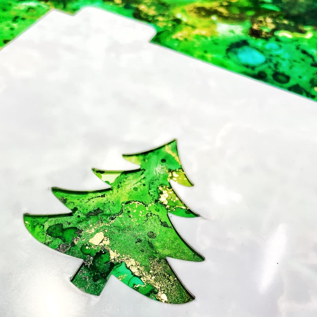 TCW5032 Single Tree Stencil over green alcohol ink background