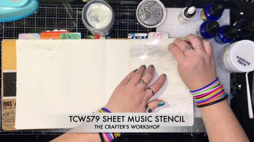 TCW9010 Silver Gesso through 6x6 TCW579 Sheet Music Stencil.