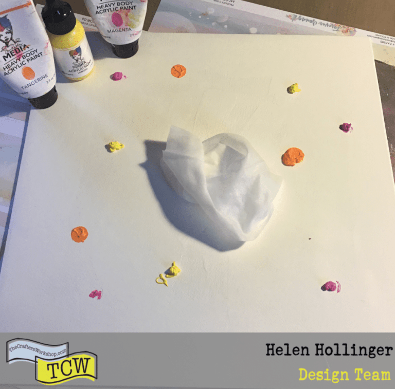 Adding acrylic ink to board in magenta, tangerine and lemon using a baby wipe to cover whole board area.