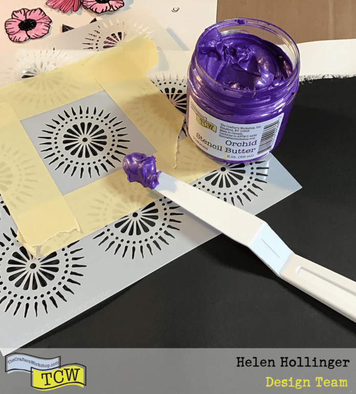 Applying Orchid Stencil Butter through the Petal Burst stencil using a palette knife.