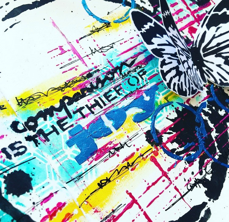 close up of grungy art journal page with butterflies and stencil work