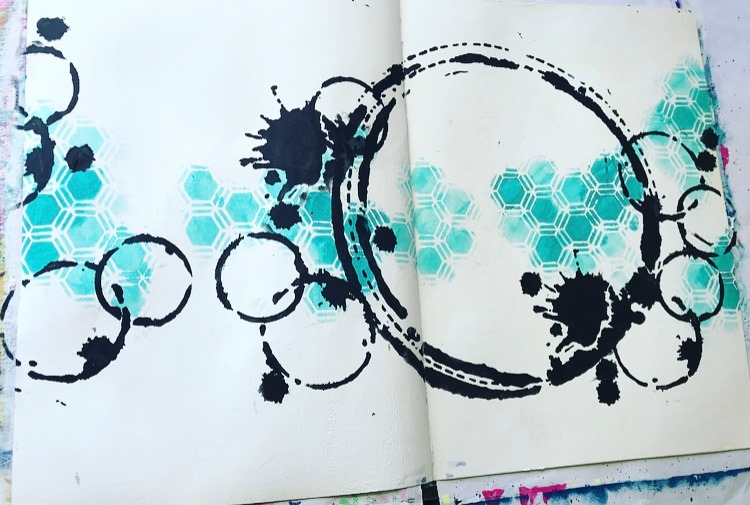 aqua honeycomb pattern with black grungy circles and splats all created with stencils