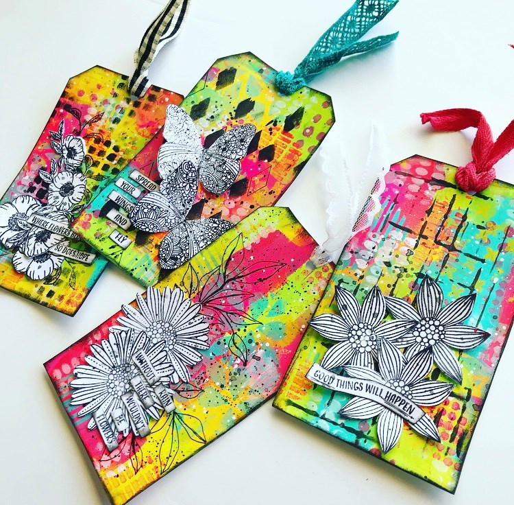 side view of the 4 tags in gelato inspired colors and stamped flowers and butterflies Tammy Klingner