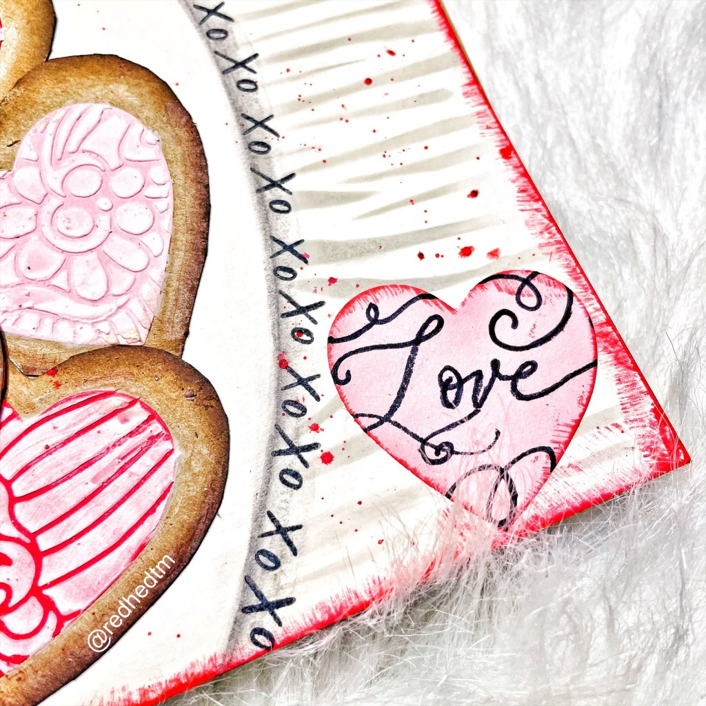 LOVE from the TCW2201 Sending Love 4x6 Clear Stamps onto pink paper heart